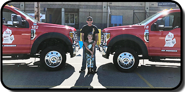 A-1 Towing and Recovery - Chad Momber with Child - Newaygo, MI